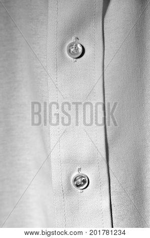 Closeup of white dress shirt buttons business formal wear