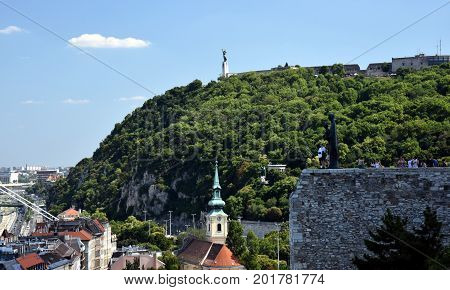 Statue of Liberty Gellert hill Budapest Hungary. Panorama of the city with a statue on the horizon.