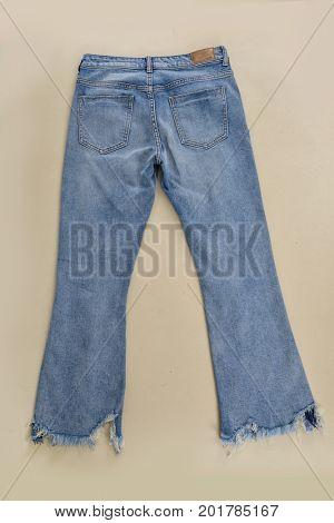 Set of back blue jeans on khaki background