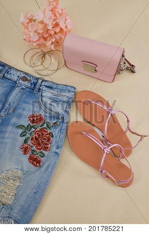 embroidery,floral Jeans,shoes,bag,bracelt-khaki background