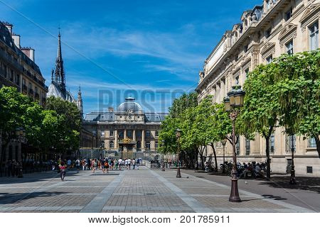 Paris France - August 13 2016: The Palais de Justice and the square Louis Lepine.The justice of the state has been dispensed at this site since medieval times.