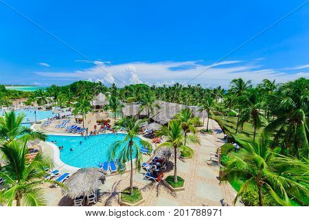 Cayo Coco island, Cuba, Sol Cayo Coco hotel, July 15, 2017, amazing beautiful inviting view of hotel grounds and people relaxing in swimming pool and enjoying their time on sunny nice day