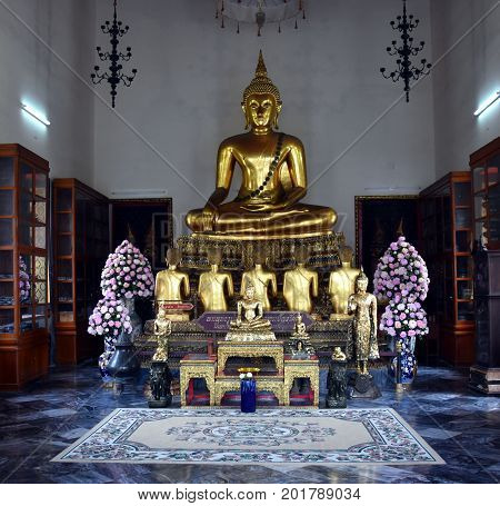 Bangkok Thailand - Aug 4 2017. Golden Buddha statue in Wat Pho. Wat Pho is a Buddhist temple complex with Reclining Buddha.
