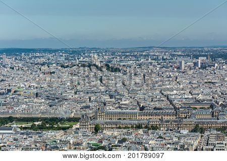Skyline of Paris from the top of the Montparnasse tower. We can see the Louvre museum the Tuileries garden the Madeleine church the basilica of the Secred Heart ...