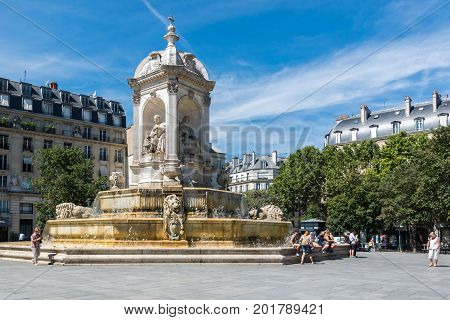 Paris France - August 14 2016: The Fountain Saint-Sulpice or Fountain of the Four Bishops. It presents the statues of four bishops one on each of its sides