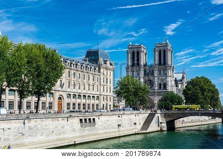 Paris France - August 13 2016: The Cathedral Notre-dame de Paris and the river Seine. Notre-Dame is a medieval Catholic cathedral on the ile de la Cite in the fourth arrondissement of Paris France.