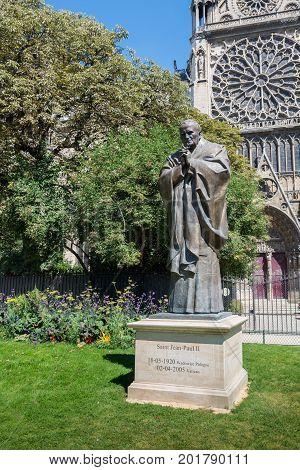 Paris France - August 13 2016: The Statue of Saint (Pope) Jean-Paul II in Paris near the cathedral Notre-Dame de Paris