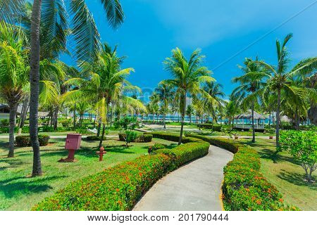 Cayo Coco island, Cuba, Sol Cayo Coco hotel, July , 2017, amazing beautiful inviting view of hotel grounds with tropical garden leading to the beach and ocean on sunny nice day