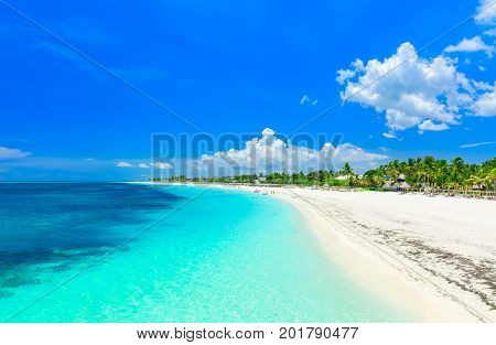 stunning gorgeous, amazing view of a tropical white sand beach and tranquil turquoise ocean at Cayo Coco island, Cuba on sunny beautiful summer day