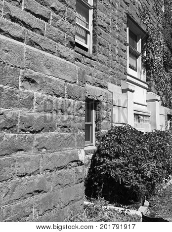 The wall of the historic Crook County courthouse in Central Oregon made from local geology on a sunny summer morning.