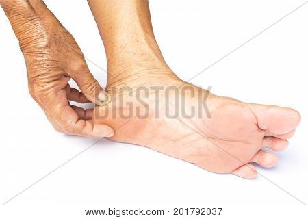 Hand holding feet old women take care feeling with white background