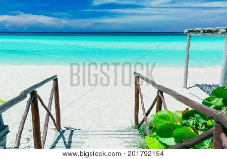 amazing stunning view of tropical white sand beach and inviting tranquil, turquoise ocean on blue sky background at Cayo Coco Cuban island