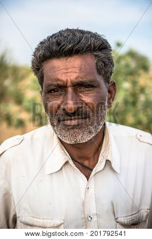 JAISALMER RAJASTHAN INDIA - MARCH 07 2016: Vertical picture of native indian man in Thar Desert located close to Jaisalmer the Golden City in India.