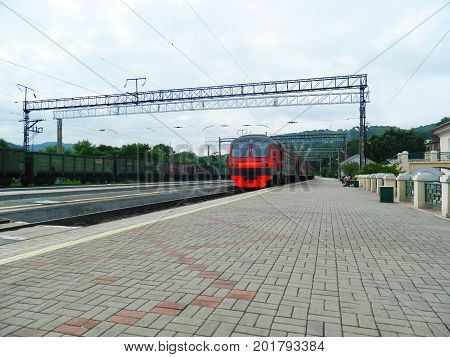 electric train on the platform of the passenger station of the Pacific Nakhodka station. Russia June 2017 .