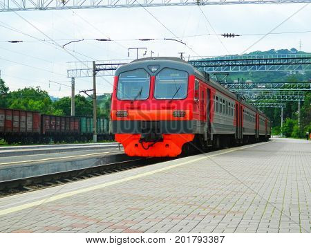 electric train on the platform of the passenger station of the Pacific Nakhodka station. Russia June 2017.