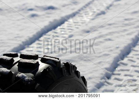 Closeup of an ATV Tire and it's Tracks.