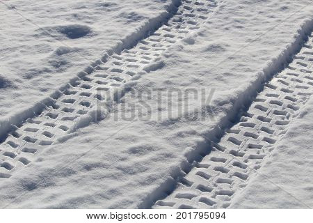 Fresh double ATV tracks in the snow.