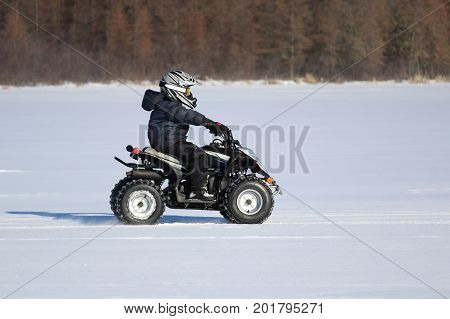 Driving a Quad in Winter across a frozen lake