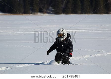 Child Wearing An Ohv Stepping Through Deep Snow