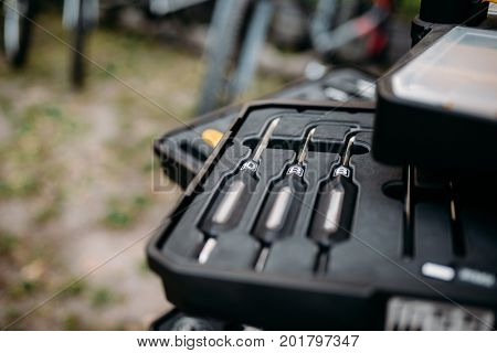 Bicycle tools in box closeup,  blur background