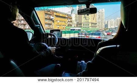 Shanghai, China - Nov 5, 2016: View from inside the tour shuttle bus of the traffic congestion on a major road. This is a daily occurrence, even on weekends.