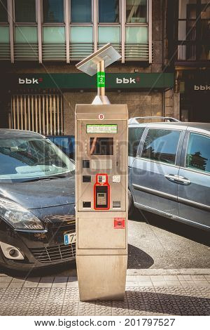 BILBAO SPAIN - July 19 2016 : In the street a park meter powered by a solar panel in the city of Bilbao Spain
