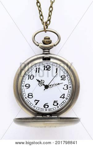 old pocket watch with chain on white background