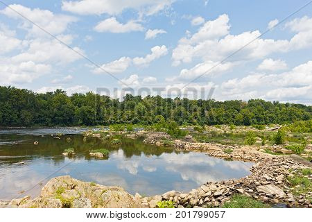 Potomac River during summer in Virginia USA. A small pond made on Potomac River with clouds reflection.