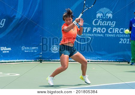BANGKOK MAY 27 : Yugi Sheng of China action in Chang ITF Pro Circuit 4 International Tennis Federation 2015 on WS main draw at Rama Gardens Hotel on May 27 2015 in Bangkok Thailand.