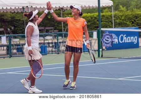 BANGKOK MAY 27 : Ching-Wen of taipei and Nungnadda Wannasuk of Thailand action in Chang ITF Pro Circuit 4 International Tennis 2015 at Rama Gardens Hotel on May 27 2015 in Bangkok Thailand.