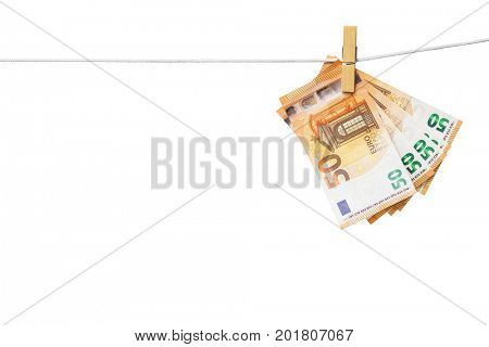 Money laundering concept -Euro banknotes hanging on clothesline isolated on white, included clipping path