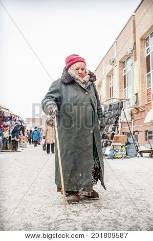 Orenburg, Russia, January 29, 2010. An Old Lonely, Homeless, Poor Woman Walks The Central Market Of