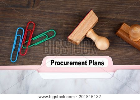 Procurement Plans. Folder Register on a dark wooden desk.