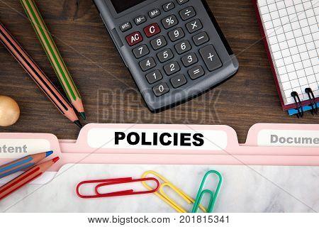 Policies concept. Folder Register on a dark wooden desk.
