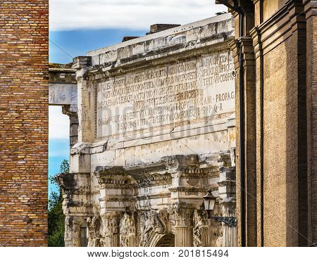 ROME, ITALY - January 19, 2017 Colosseum Arch of Constantine Rome Italy Arch built in 315 AD to celebrate Emperor Constantine's victory in 312 over co-emperor Maxenntius. Constantine attributed victory to vision of Jesus Christ made Christianity legal
