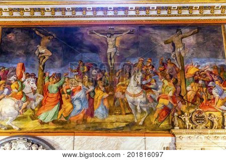 ROME, ITALY - January 19, 2017 Crucifixion Fresco Chiesa San Marcello al Corso Altar Dome Frescoes Basilica Church Rome Italy. Built in 309 rebuilt in 1500s after sack of Rome. Frescoes are from the 1600s
