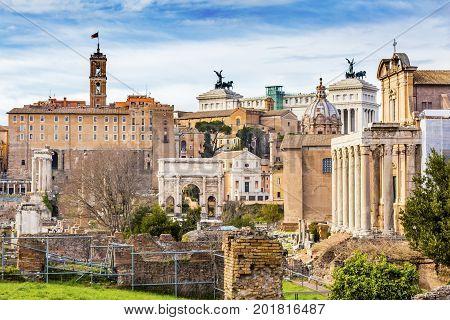 Roman Forum Septemus Severus Arch Capatoline Hill ColumnsRome Italy. Forum rebuilt by Julius Ceasar in 46 BC