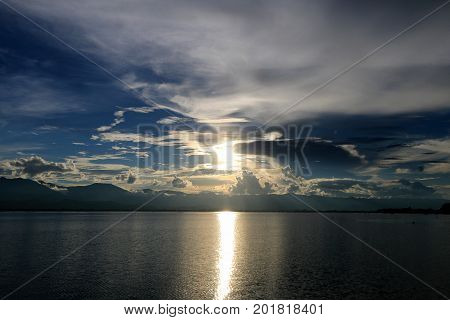 Beautiful Sunset And Evening Sky With Mountain And Clouds And Sunset Reflected In The Lake For Backg