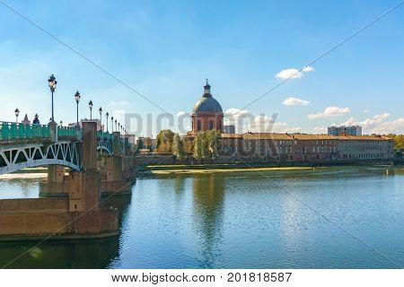View of Saint-Pierre Bridge over Garonne river and Dome de la Grave in Toulouse France
