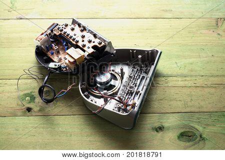Broken Clock Radio on a Wooden Background