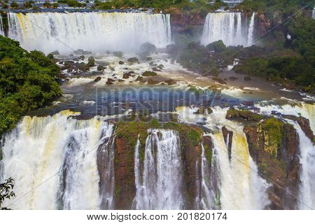 Most abounding in water Iguazu Falls in the world. Border of Argentina, Brazil and Paraguay.  Concept of active and extreme tourism
