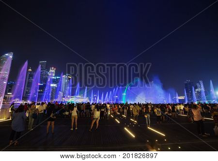 Tourists Visit Spectra – Light & Water Show At Marina Bay Sands Front In Singapore