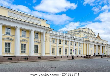 SAINT PETERSBURG RUSSIA - MAY 4 2017: Unknown people are walking along street near famous Russian Ethnographic Museum St. Petersburg Russia