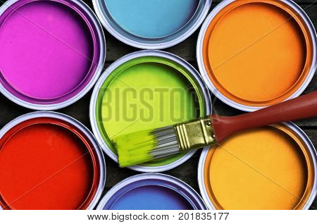 Seven colorful decoration paint with a brush