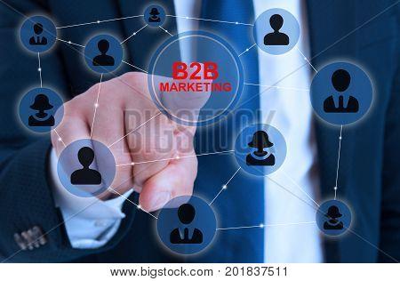 Businessman Touching B2B Icon On Virtual Screen