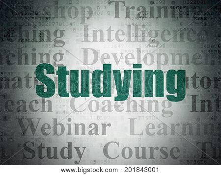 Learning concept: Painted green text Studying on Digital Data Paper background with   Tag Cloud