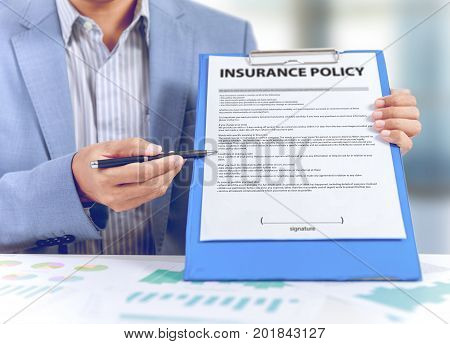 businessman show insurance policy with business graph diagram, insurance concept