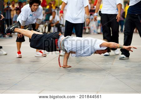 Thai Male Breakdancers One Handed Plank