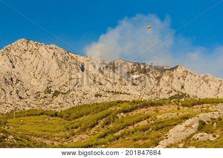 Promajna, Biokovo, Croatia, 24. August 2017 - Firefighting On Biokovo By Two Canadair Cl-415