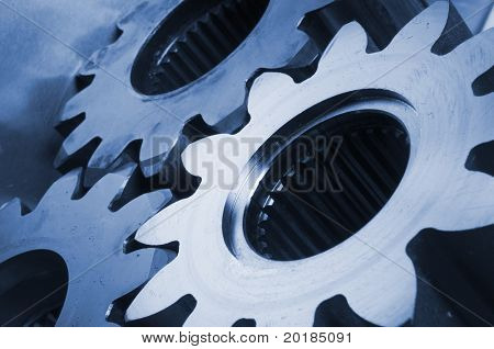 three cogs in blue